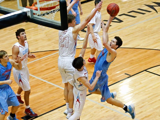 Glendale High School guard Tristan Baker (11) jumps