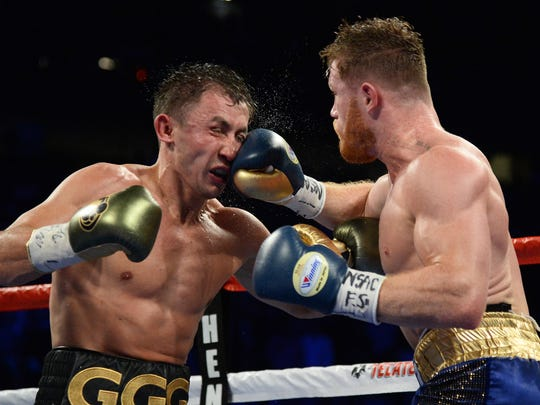 "This file photo from Sept. 16, 2017 shows Gennady Golovkin, left, taking a punch to the face by Saul ""Canelo"" Alvarez during their world middleweight boxing championship fight at T-Mobile Arena in Las Vegas."