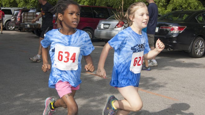 Children race to the finish at the Rochester Youth Triathlon.
