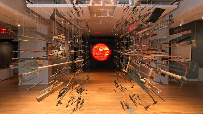 """This photo provided by Cooper Hewitt, Smithsonian Design Museum shows the-installation view of """"Tools: Extending Our Reach"""" featuring Controller of the Universe by Damián Ortega and Solar Wall at the museum in New York. The Cooper-Hewitt Smithsonian Design Museum, revamped, restored and seriously expanded after a three-year closure, reopened at last, all decked out for the 21st century within its historic Carnegie Mansion home."""