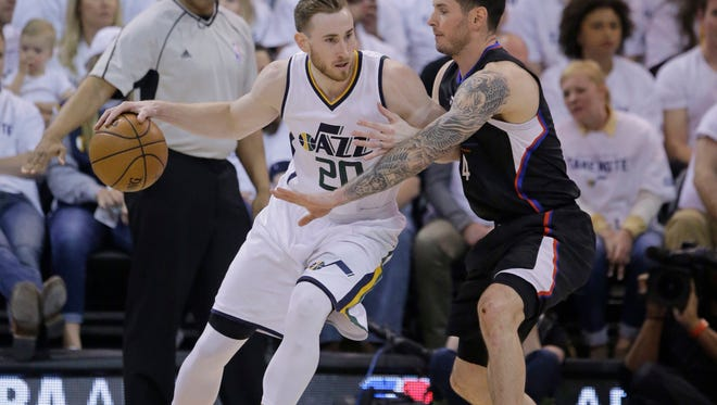 Los Angeles' JJ Redick, right, guards Utah's Gordon Hayward during the first half of Friday's playoff game in Salt Lake City.