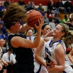 Providence High School's Marissa Hornung (12) fights for the rebound with Heritage Christian High School's Allison Schofield (44) during the first half of play in the 40th Annual Girl Class 2A Basketball Semi-State Tournament at Jeffersonville High School in Jeffersonville, Indiana.    February 28, 2015