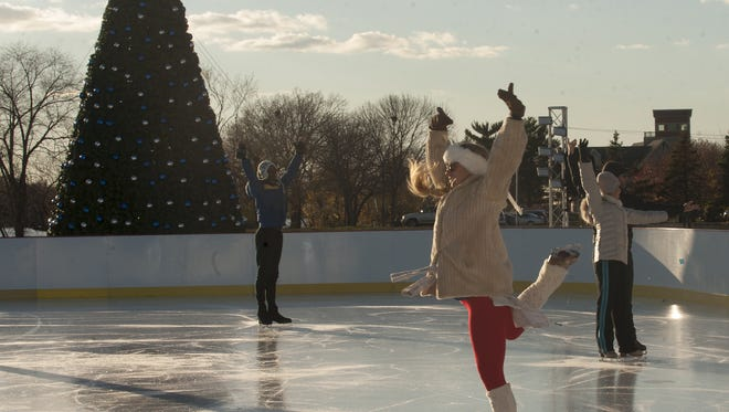 Ice dancer Alex Murphy (center) rehearses the show on ice at Camden County's WinterFest at Cooper River Park in Pennsauken. Ice dancing shows are a fun aspect of the pop-up festival.