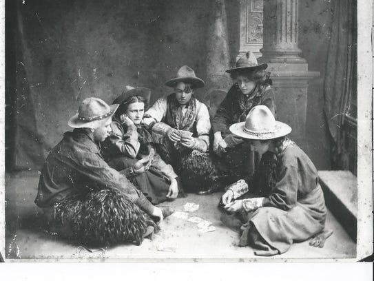 "Maxwell ""Freckles"" Atkinson, far left, plays cards"