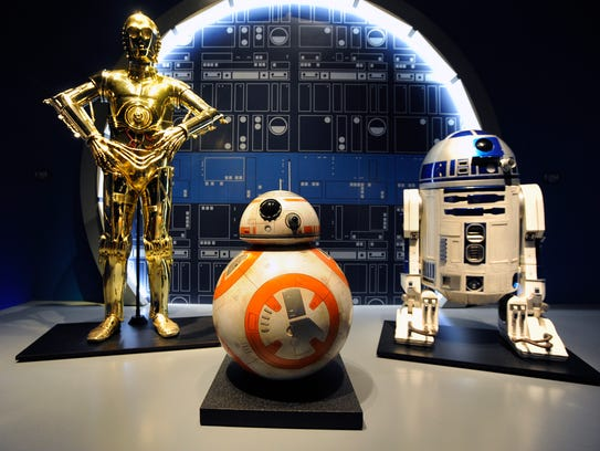 From left are the costumes for C-3PO in the 1980 film