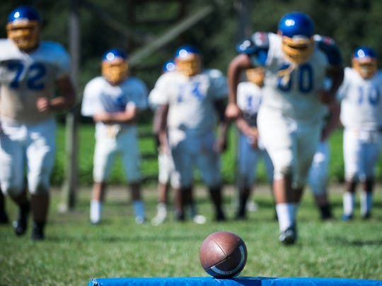 The Sussex Central varsity team takes the field as they practice in Georgetown.