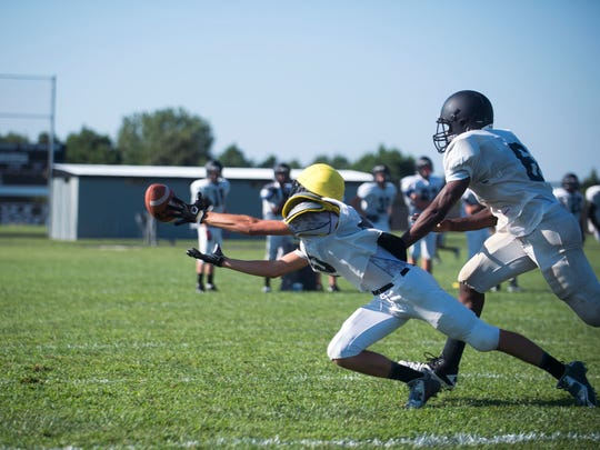 Junior Coleman James dives for a pass during varsity practice at Sussex Tech High School in Georgetown.