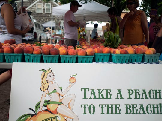 Bennett Orchards offers fresh peaches to patrons shopping the Lewes farmers market Saturday, July 19.