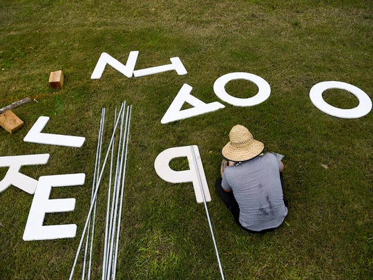 Ben Fieker builds the Planet Roo sign in preparation next weeks music festival on the Bonnaroo Property in Manchester, Tenn., Wednesday, May 31, 2017.