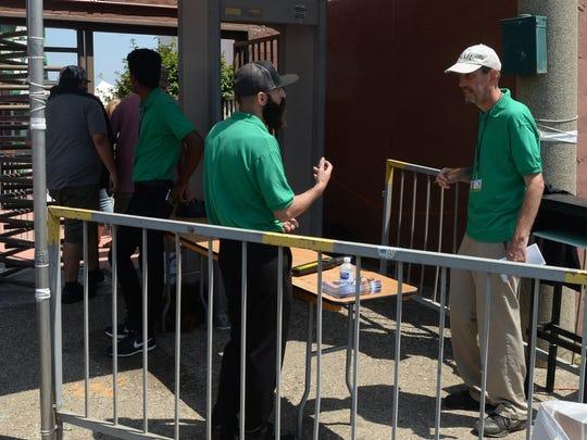 Fair employee Alfredo Preciado, left, talks with Ventura County Star reporter Tom Kisken at the main entrance of the Ventura County Fair.