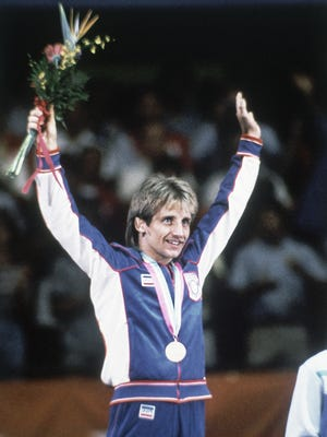 American wrestler Randy Lewis on the podium after winning the gold medal in the Men's 57 kilogram Freestyle Wrestling event at the Summer Olympic Games in Los Angeles, California, USA on August 10, 1984.