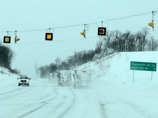 Plow crews work to clear the roads on Saturday.