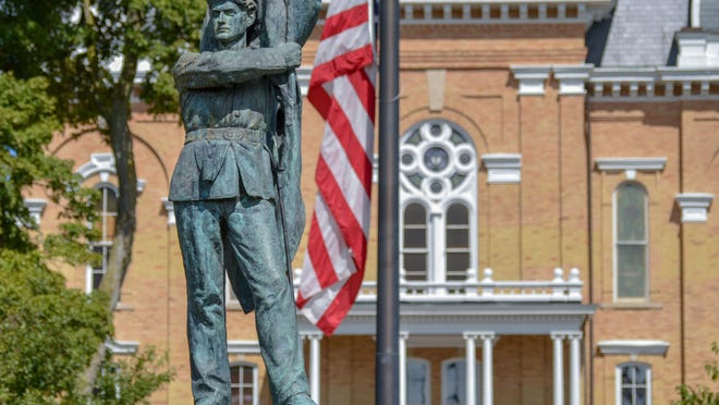 Hillsdale College's Central Hall pictured behind the backdrop of the campus's Civil War Memorial. Sam Fry/Hillsdale Daily News Photo