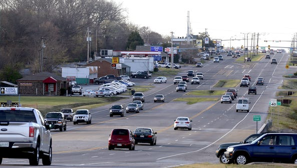 Afternoon traffic travels on South Lowry Street in