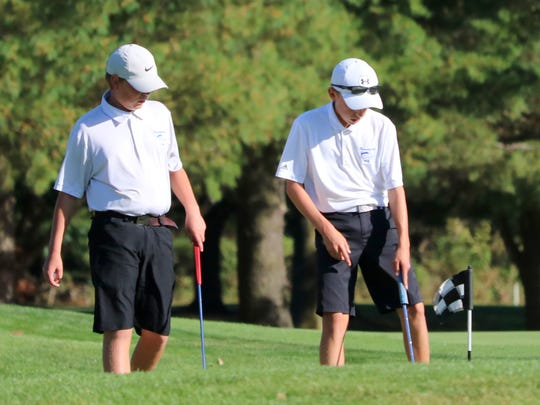 Horseheads golfers Zack Locke, left, and Seth Conway