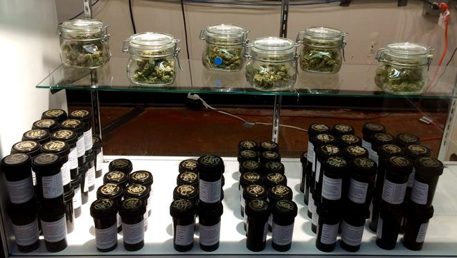 A display case inside the High Level Health marijuana store in Denver showcases the legal — and taxed — pot available for sale.