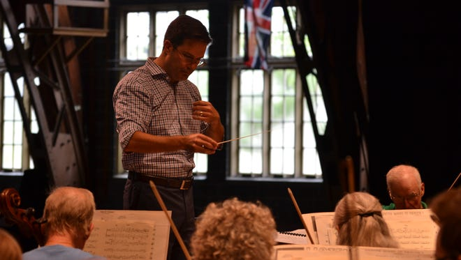 The five men vying to become Lakeside Symphony Orchestra's next conductor were invited to be guest conductors this summer, which creates a public, hands-on interview process. Here, Guest Conductor Matthew Kraemer practices with the orchestra on July 30.