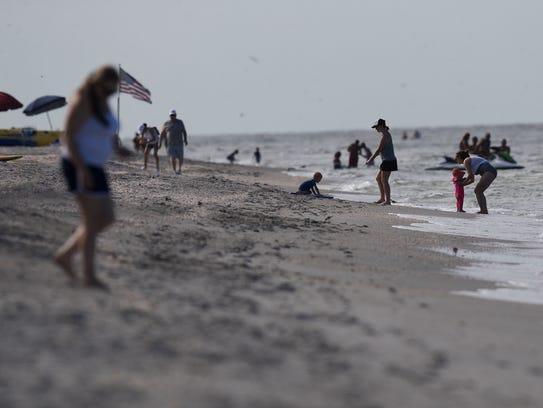 Visitors enjoy the beach on Captiva near Andy Rosse