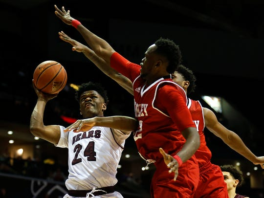 Missouri State Bears forward Alize Johnson (24) is committed a foul while attempting a shot during first half action of the Missouri Valley Conference college basketball game between the Missouri State Bears and the Bradley Braves at JQH Arena in Springfield, Mo. on Jan. 21, 2017.
