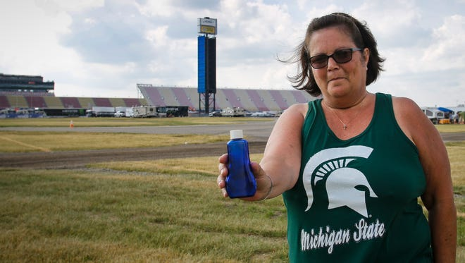 """""""This is where he would've wanted to be, his favorite place in the world was the racetrack,"""" Kim Fedewa-Eaton said Wednesday, June 14, 2017, holding an empty urn that the day before held the ashes of her late ex-husband Mark Wilson. Wilson, a life-long NASCAR fan and former pit crew member died last January from COPD.  Fedewa-Wilson and her husband Jeff sprinkled some of Wilson's ashes underneath the frontstretch scoring pylon Tuesday, at Michigan International Speedway in Brooklyn. They sprinkled the rest at the checkered MIS start-finish line, Wilson's """"home-away-from-home."""""""