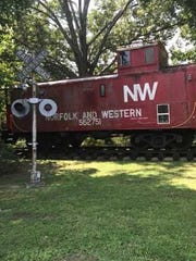 An old caboose sits on the east end of Oaklawn Garden,
