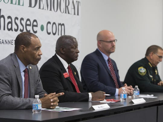Candidates for Leon County Sheriff answer questions during an editorial board meeting at the Tallahassee Democrat.