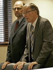 Retired Brick Township administrator and Birdsall chief administrative officer Scott MacFadden, left, attends his senetncing for his role a play-to-play scandal at the Ocean County Courthouse Sept. 29, 2017.  Right is attorney William P. Cunningham.
