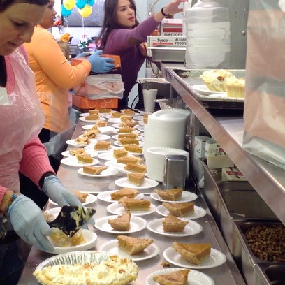 Volunteers prepare to serve food for Thanksgiving day at Red Rock Canyon School.