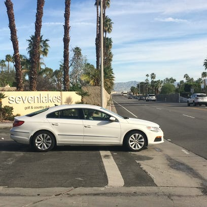 A dangerous Palm Springs wall is being downsized Friday to improve drivers' visibility