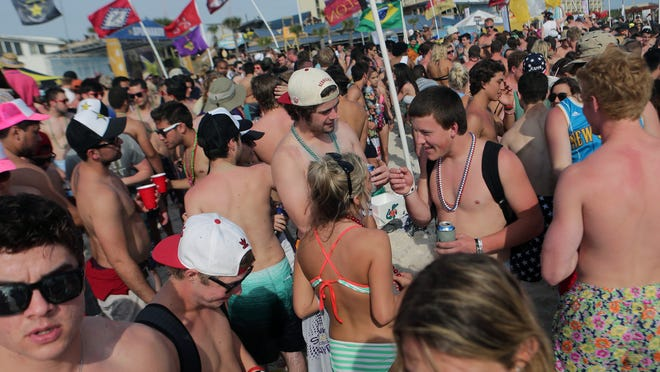 Party goers fill the sand behind Club La Vela and Spinnaker Beach Club during the fourth week of spring break on Wednesday, March 25, 2015, in Panama City Beach, Fla. (AP Photo/News Herald, Heather Leiphart)  MANDATORY CREDIT ORG XMIT: FLPAN105