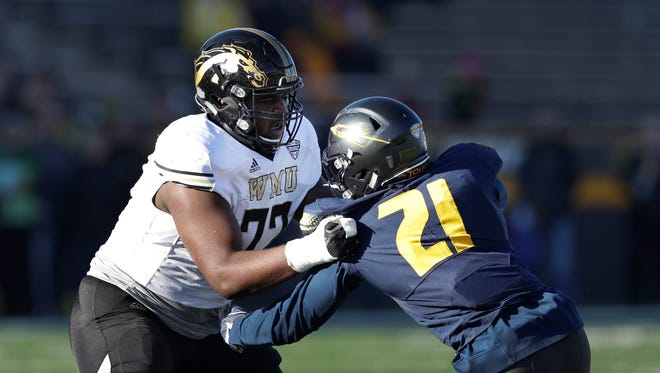 Chukwuma Okorafor, left, was the third Western Michigan offensive lineman to be selected in the NFL Draft the last three years.