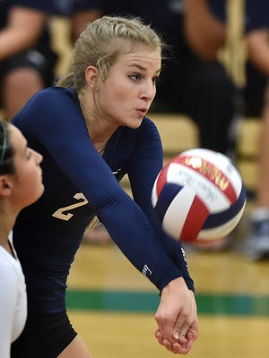 Damonte Ranch's Meagan Carlson returns a shot to Bishop Manogue during Thursday's game at Damonte  on Oct. 1, 2015.