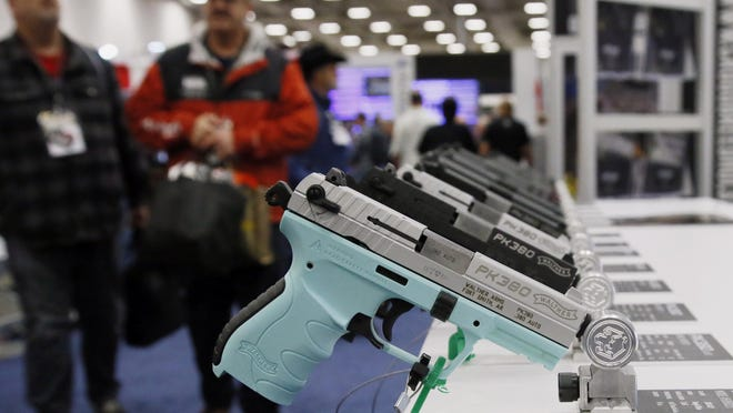 FILE - In this May 4, 2018, file photo, handguns are on display at the NRA convention in Dallas. The National Rifle Association is gathering for its 148th annual meeting beginning Thursday, April 25, 2019, in Indianapolis. (AP Photo/Sue Ogrocki, File)
