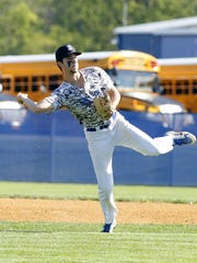 Mike Limoncelli throws to first for an out during a