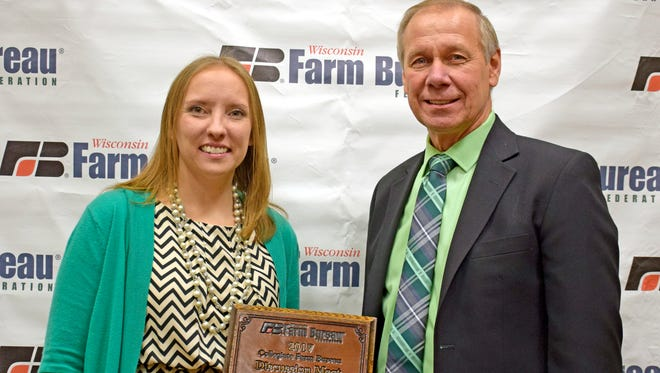 Jamie Propson of Manitowoc County was selected winner of the 2017 Wisconsin Farm Bureau Federation Young Farmer and Agriculturist Discussion Meet contest at the organization's 98th Annual Meeting in Wisconsin Dells on Dec. 3. She is pictured with Farm Bureau President Jim Holte.