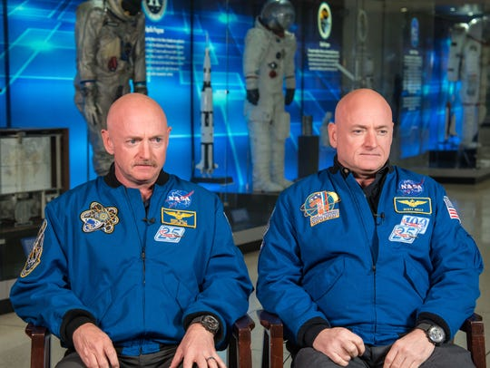 Astronaut Scott Kelly, left, and his brother, former