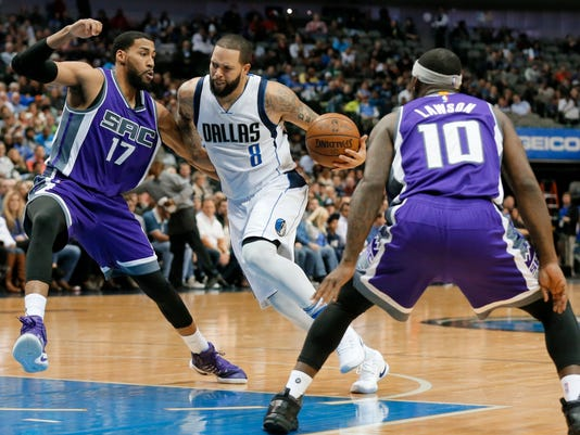 Sacramento Kings' Garrett Temple (17) ad Ty Lawson (10) defend as Dallas Mavericks guard Deron Williams (8) looks for an opportunity to the basket in the second half of an NBA basketball game, Wednesday, Dec. 7, 2016, in Dallas. (AP Photo/Tony Gutierrez)
