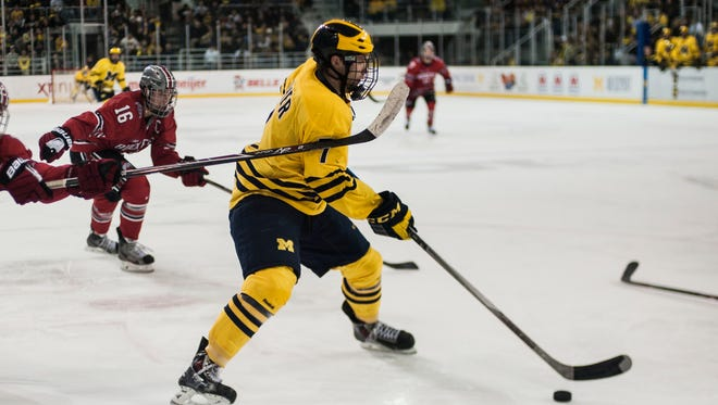 JT Compher with the Wolverines in 2014.