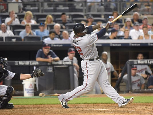 Minnesota Twins' Miguel Sano hits a two-run home run as New York Yankees catcher Brian McCann, left, looks on during the third inning of a baseball game Monday, Aug 17, 2015, at Yankee Stadium in New York. (AP Photo/Bill Kostroun)