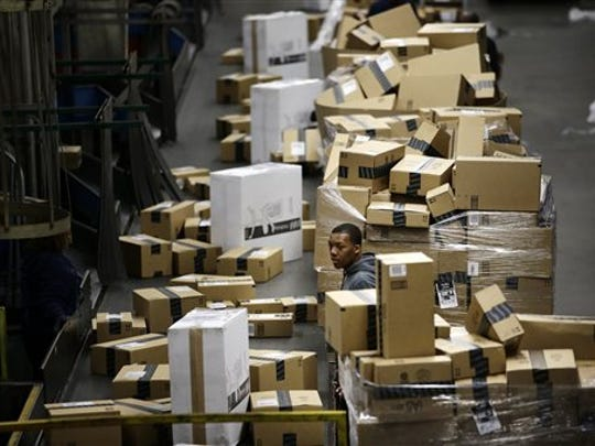 A FedEx employee sorts packages at the FedEx hub at