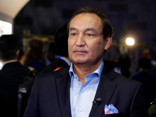 """FILE - In this Thursday, June 2, 2016, file photo, United Airlines CEO Oscar Munoz waits to be interviewed, in New York, during a presentation of the carrier's new Polaris service, a new business class product that will become available on trans-Atlantic flights. Munoz said in a note to employees Tuesday, April 11, 2017, that he continues to be disturbed by the incident Sunday night in Chicago, where a passenger was forcibly removed from a United Express flight. Munoz said he was committed to """"fix what's broken so this never happens again."""""""