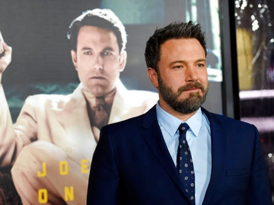 "FILE - In this Monday, Jan. 9, 2017, file photo, Ben Affleck, the director, producer, writer and star of ""Live by Night,"" poses at the premiere of the film at the TCL Chinese Theatre in Los Angeles. Court records in Los Angeles show Jennifer Garner and Affleck each filed divorce paperwork on Thursday, April 13, 2017, citing irreconcilable differences for the end of their marriage. The actors announced their intention to divorce in June 2015, and filed virtually identical paperwork Thursday to have joint custody of their three children, who range in ages from 5 to 11."