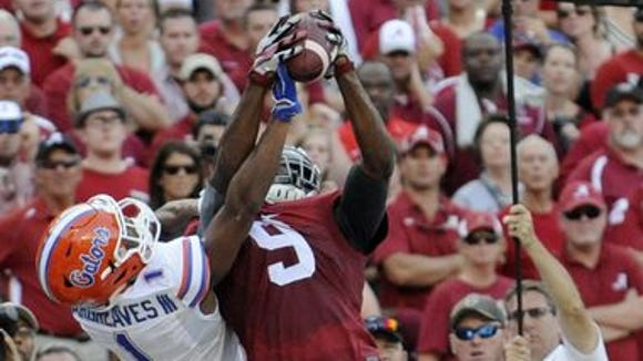 Alabama junior receiver Amari Cooper caught 10 passes for 201 yards and three touchdowns in Sunday's 42-21 win against Florida