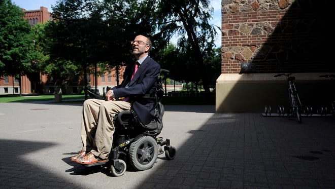 Robert Bell was injured while wrestling with another student St. John's as an undergrad.