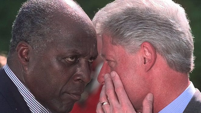 President Clinton confers with Vernon Jordan at the White House on May 12, 1999.