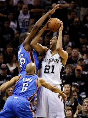 Thunder forward Kevin Durant jumps to try to stop Spurs big man Tim Duncan in Game 1 of the West finals.