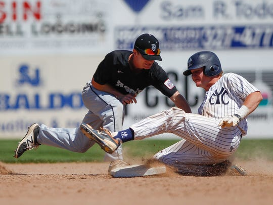 East Cobb baserunner David Smith slides into second base as Danville Hoots shortstop Sam Dinnerman applies the tag Wednesday during Game 7 during the Connie Mack World Series at Ricketts Park in Farmington.