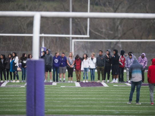 Students at Sevier County High School walk out onto