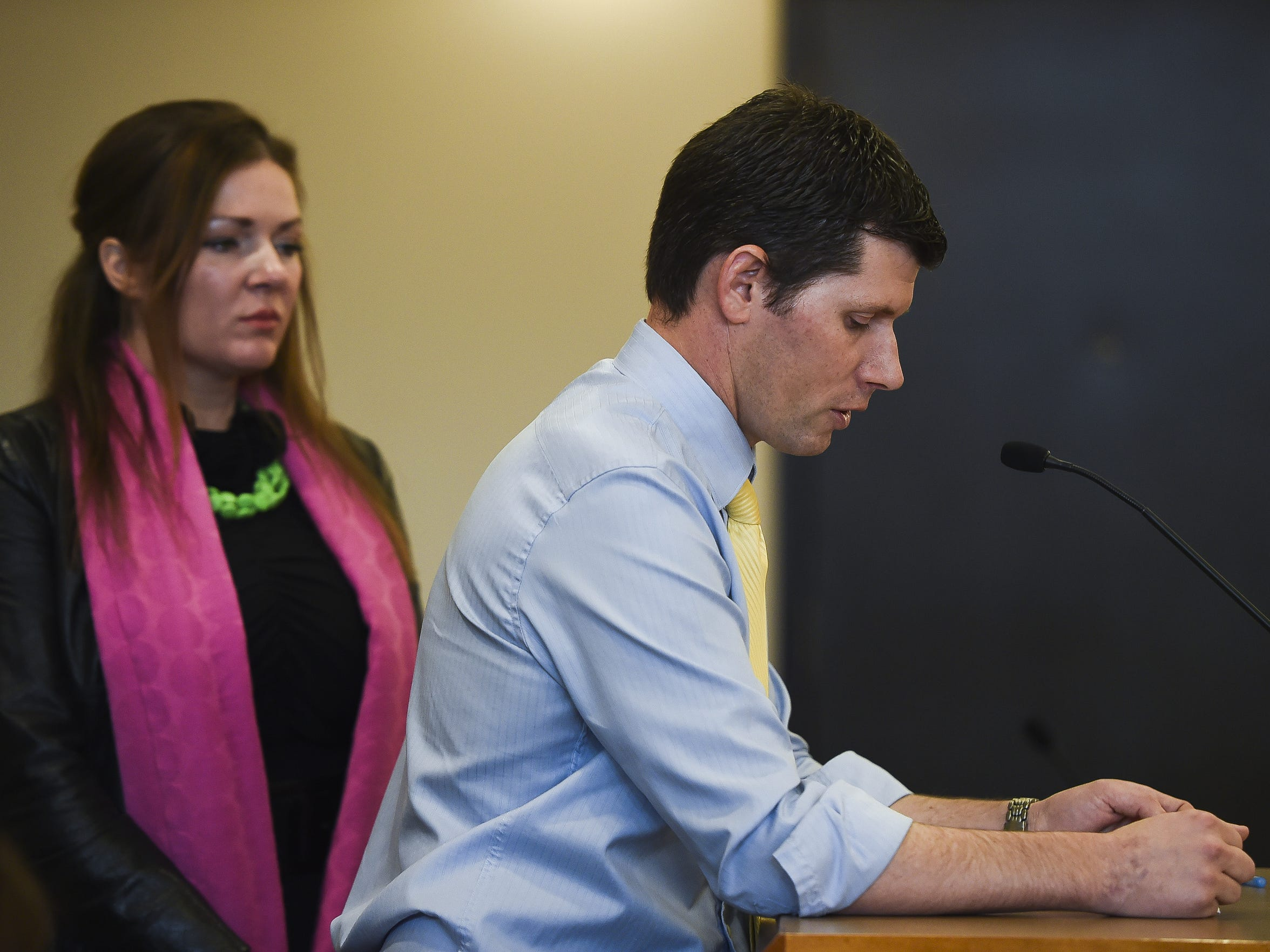 Kerry Wicks watches as her husband, Jeff Wicks, speaks