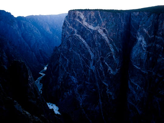 The final bits of light show off the Painted Wall at the Black Canyon of the Gunnison National Park in Colorado.